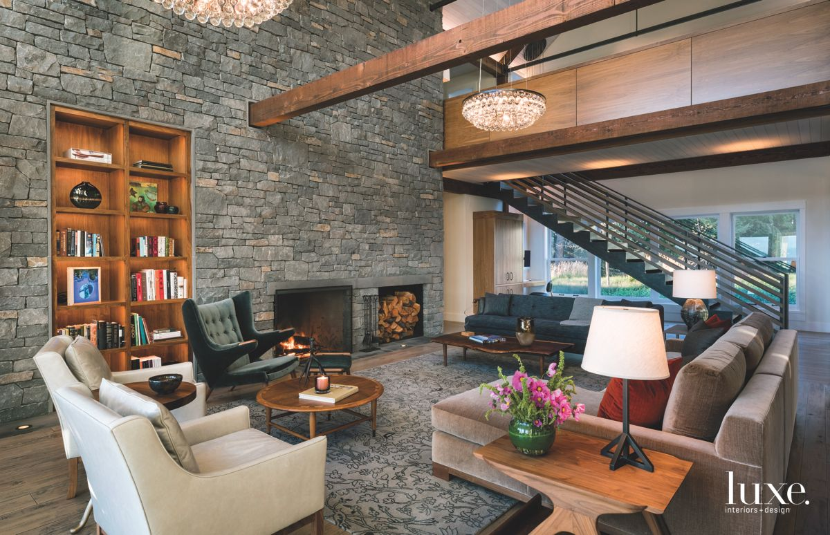 Stone Wall Living Room with Built in Bookshelf and Fireplace