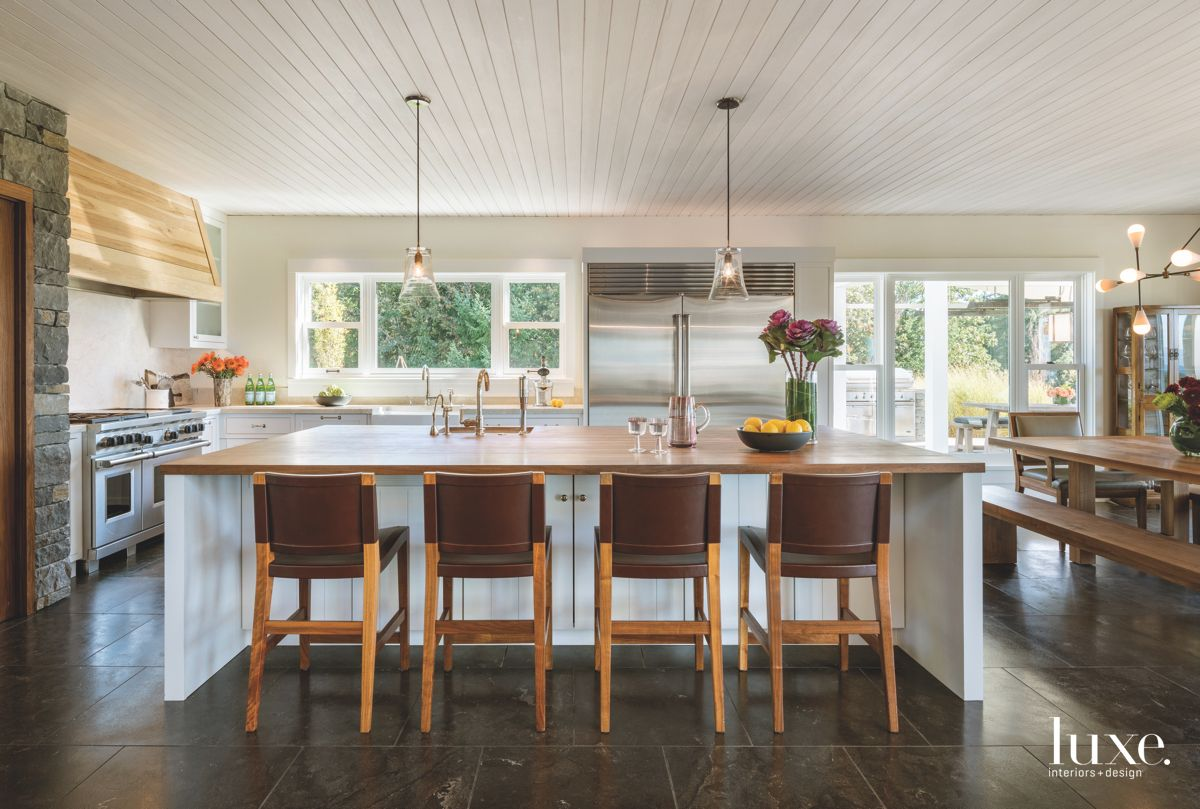 White Contemporary Farmhouse Kitchen with Pendants and Barstools