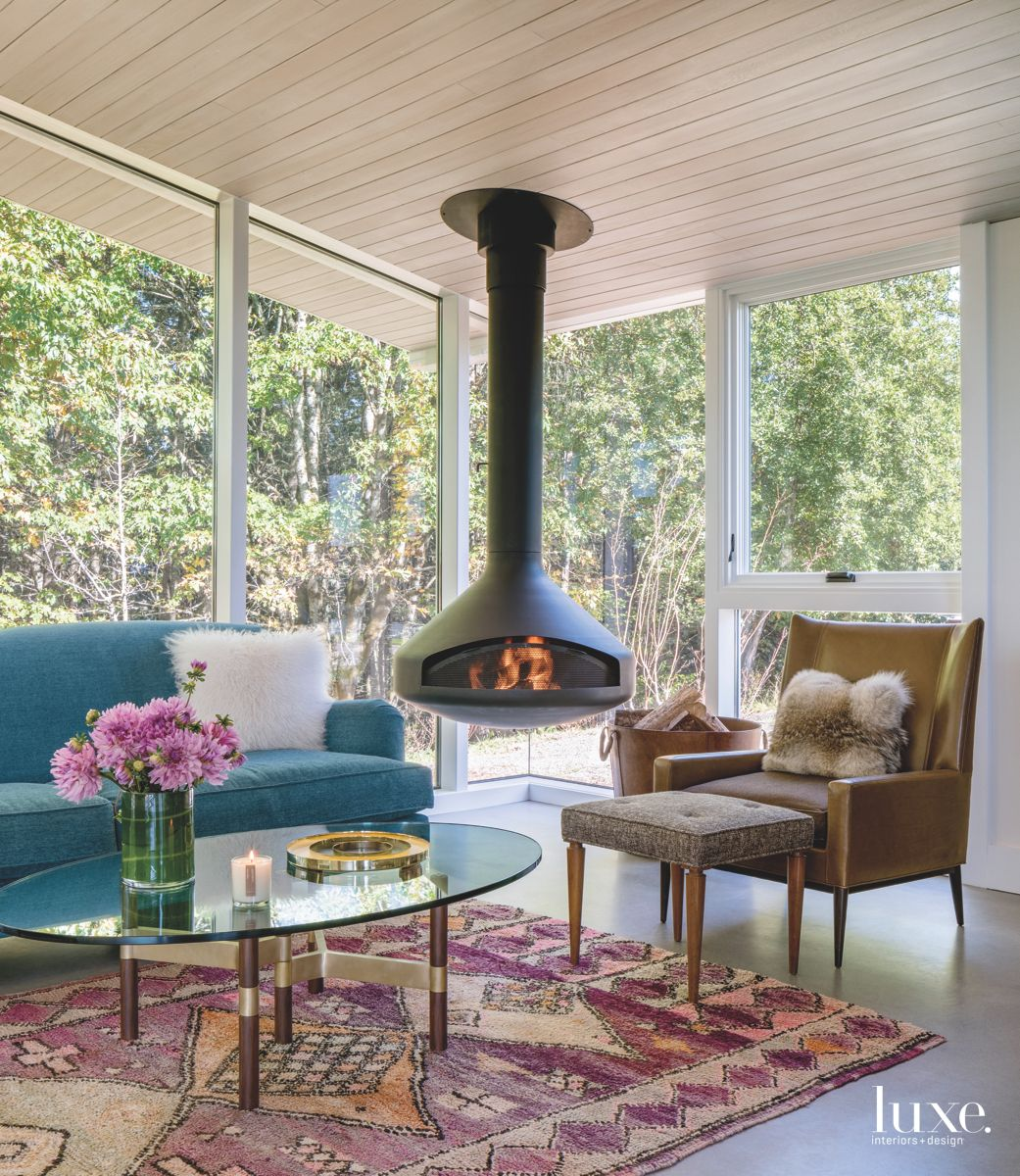Hanging Fireplace Corner with Blue Sofa and Coffee Table