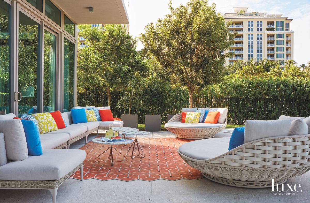Colorful Pillow Outdoor Furniture Patio Surrounded by Trees