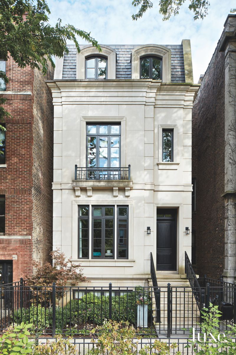 Traditional Cream Exterior Chicago Townhouse with Gate and Planter