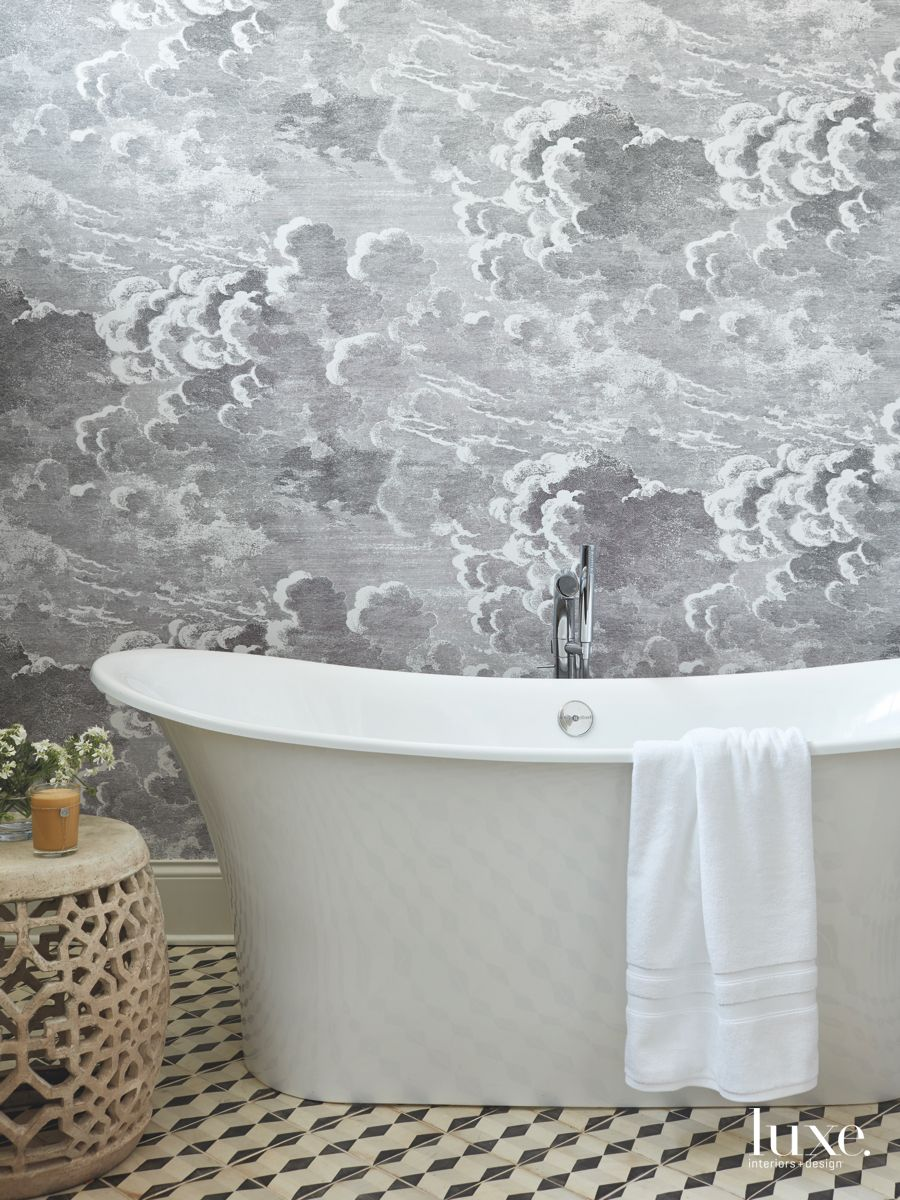 Black and White Bathroom with Cloud Wallpaper Pattern and Soaking Tub