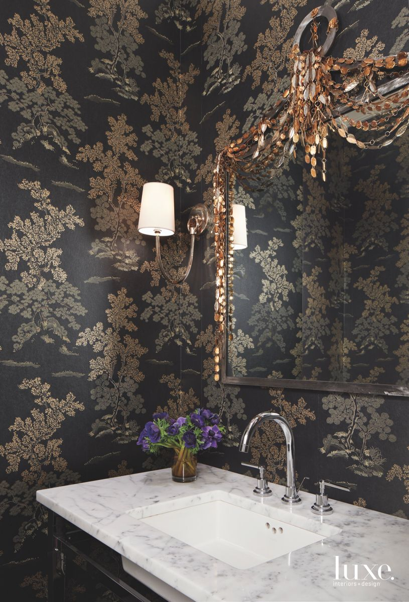 Moody Black Floral Wallpaper Bathroom with Gold Accents and Ornate Mirror