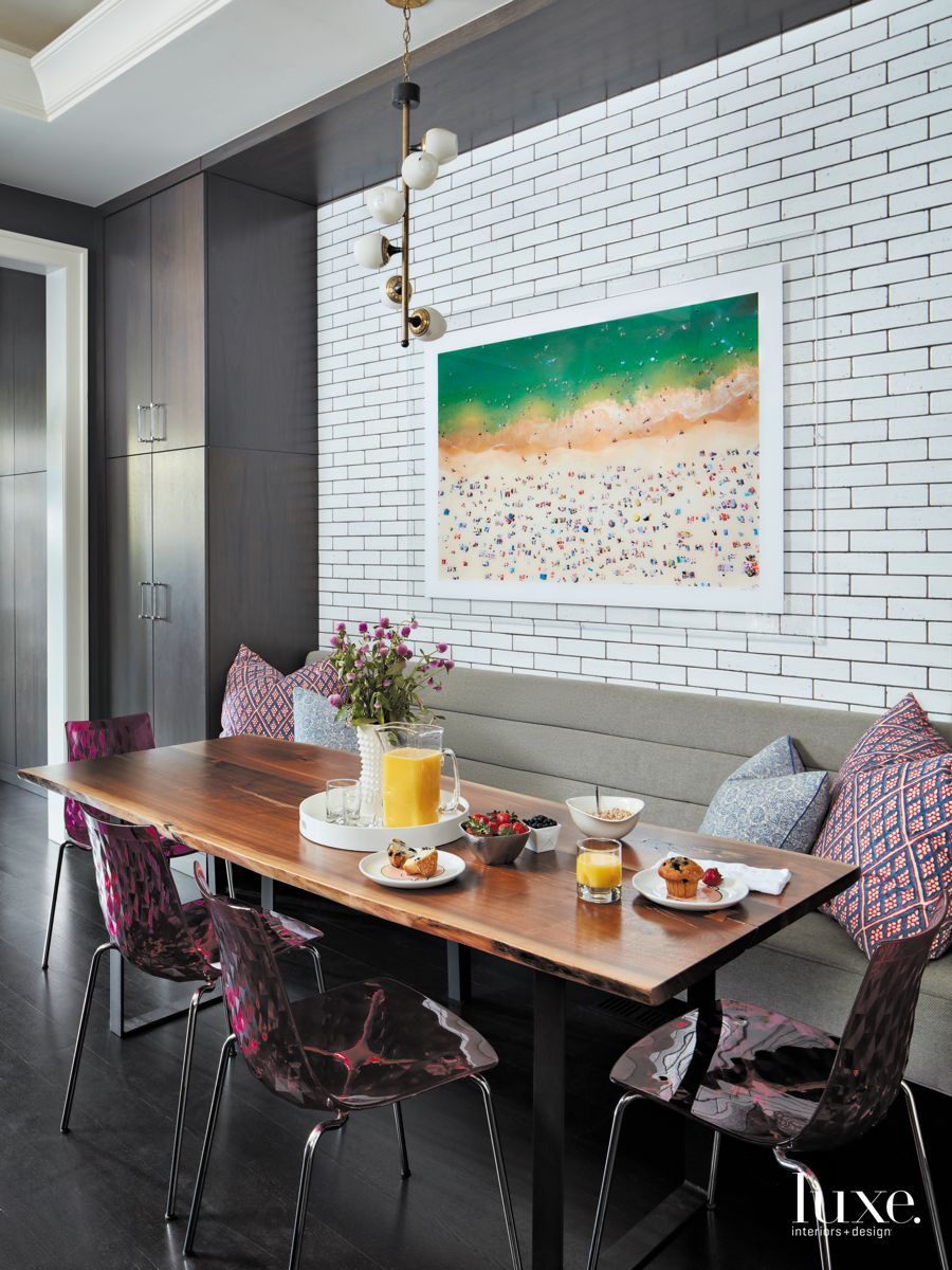 Subway Tile Dining Area with Fuschia Magenta Patterned Chairs and Pendant