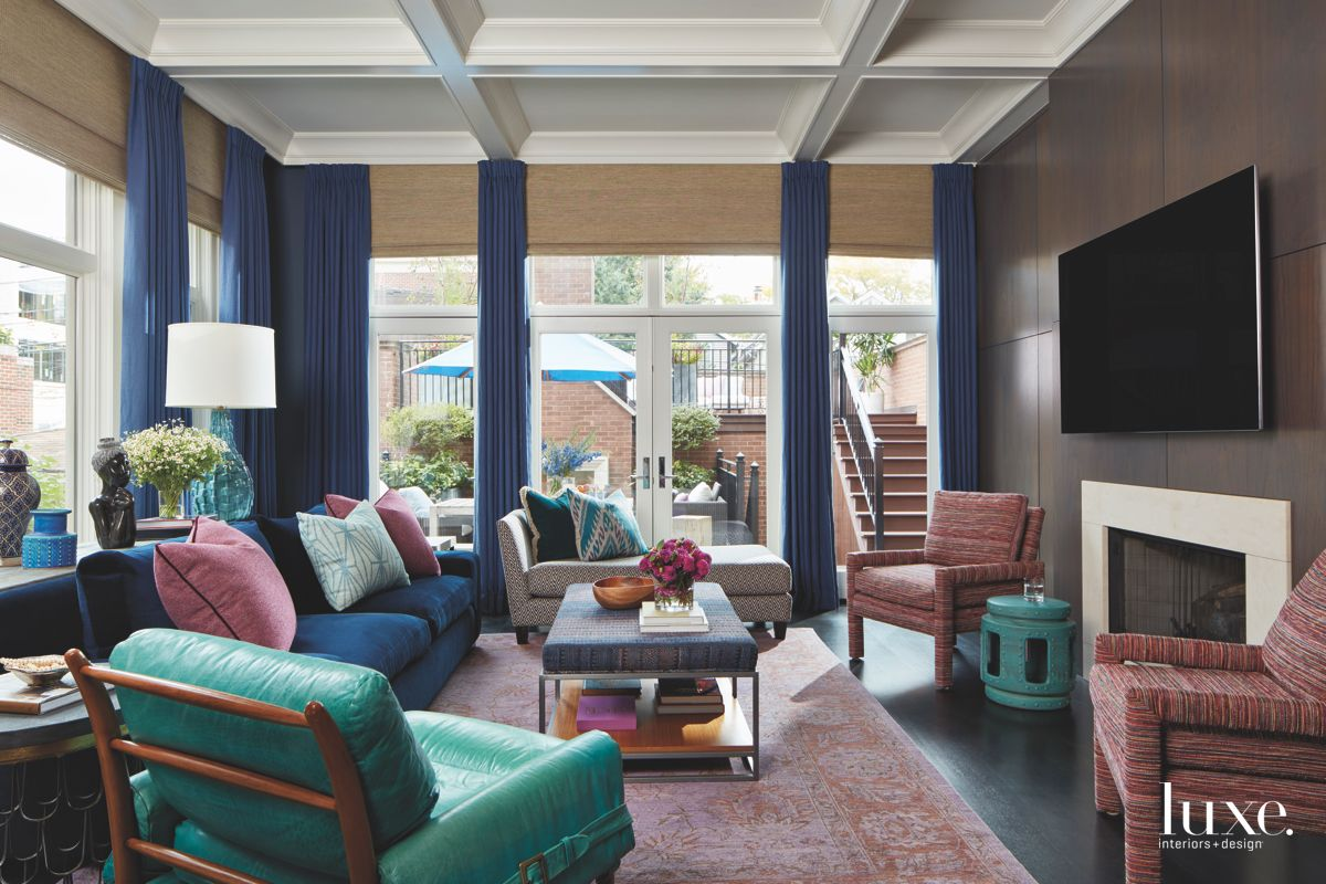 Jewel Tone Living Room with Fireplace, Curtains, and Floor to Ceiling Windows