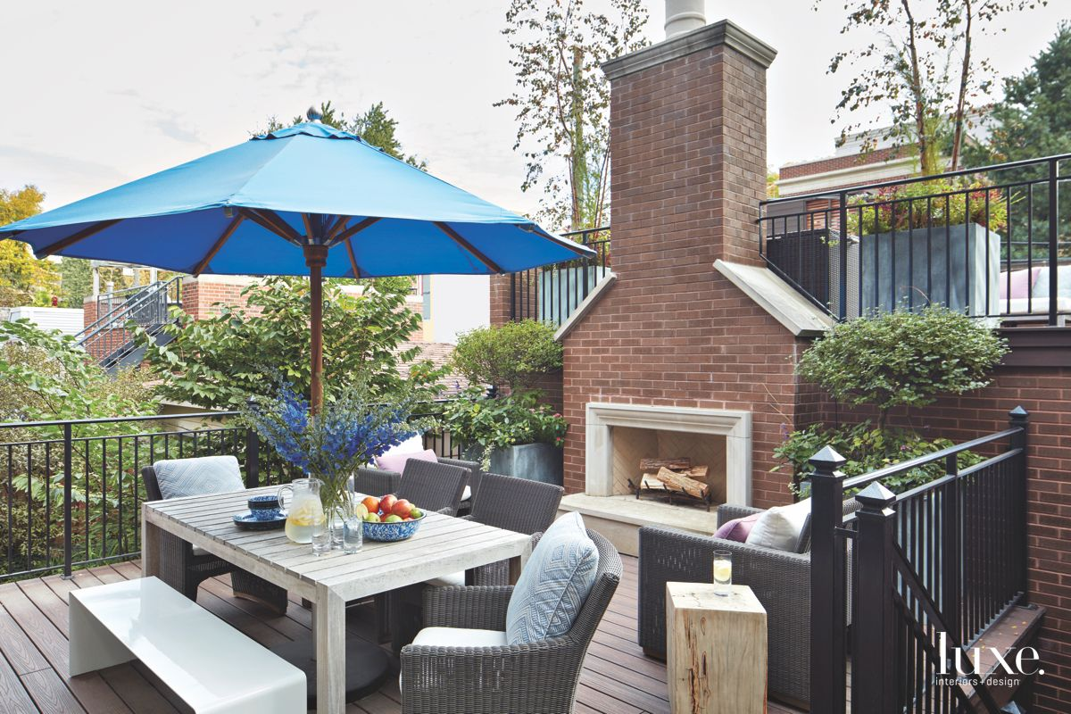 Outdoor Patio Deck Fireplace with Wicker Furniture
