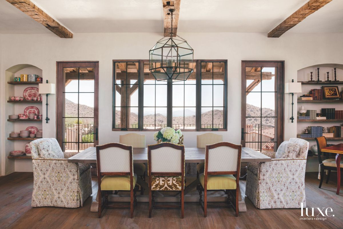 Host and Antique Chairs Featured in the Dining Room
