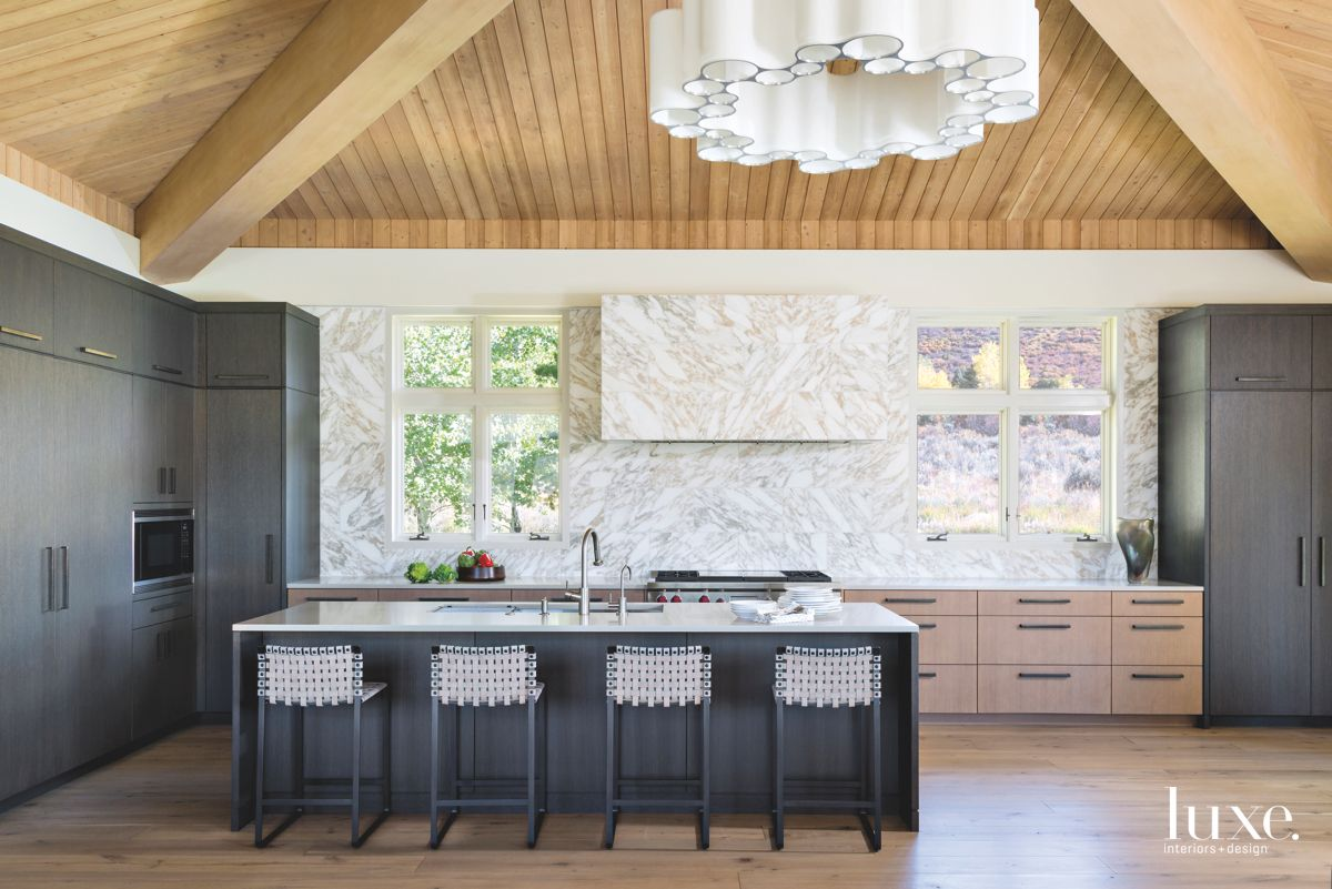 Sculptural White Chandelier Pyramid Ceiling Kitchen with Black Cabinets and Marble