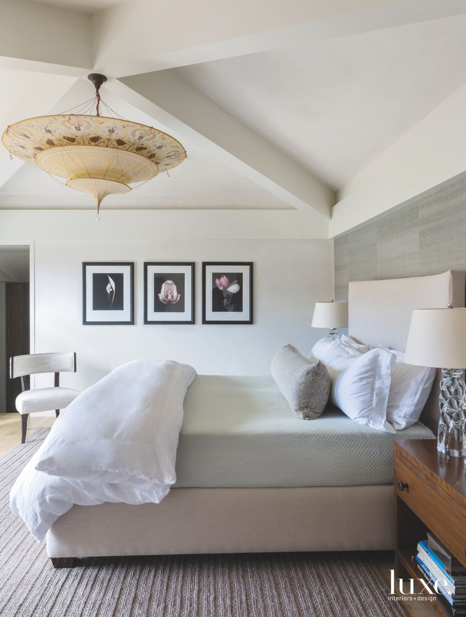 Large Parasol Chandelier Master Bedroom with Art Triptych and Stone Wall