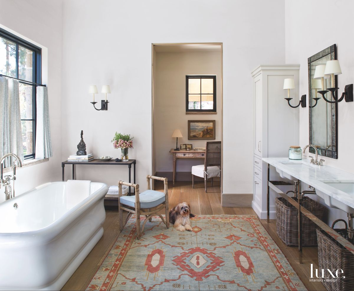 Large Tub Master Bathroom with Patterned Rug, Picasso Art, and Dog Laying Down