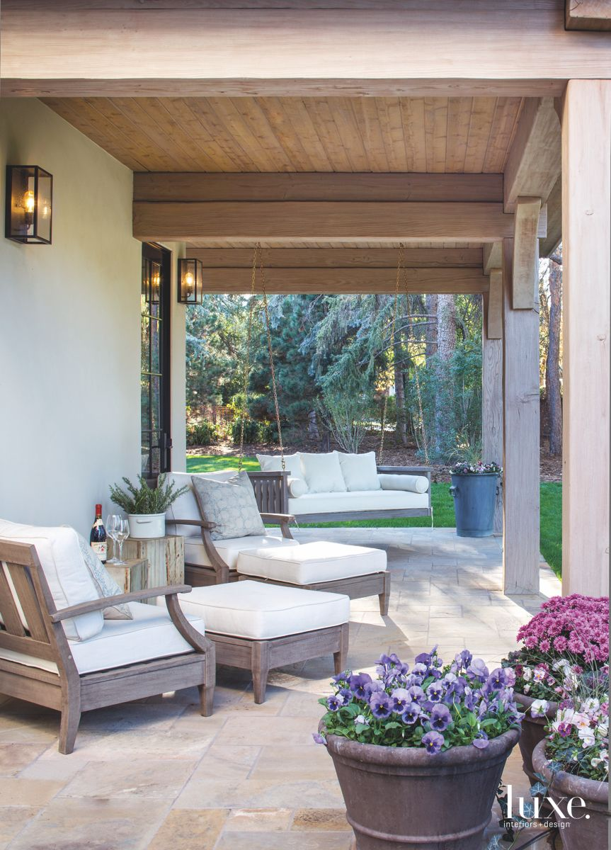 Porch Swing Veranda with Outdoor Furniture and Potted Flowers