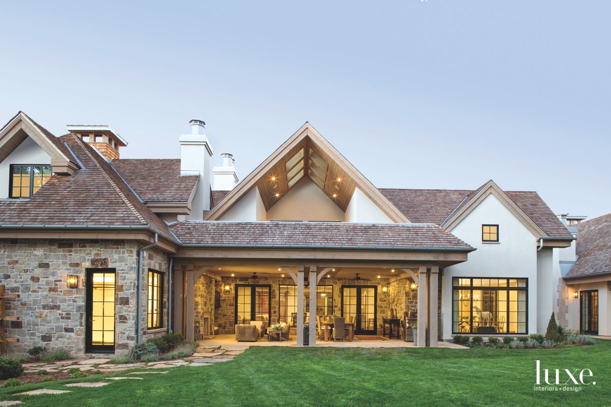 Traditional Colorado Home Rear Exterior with Stonework and Yard