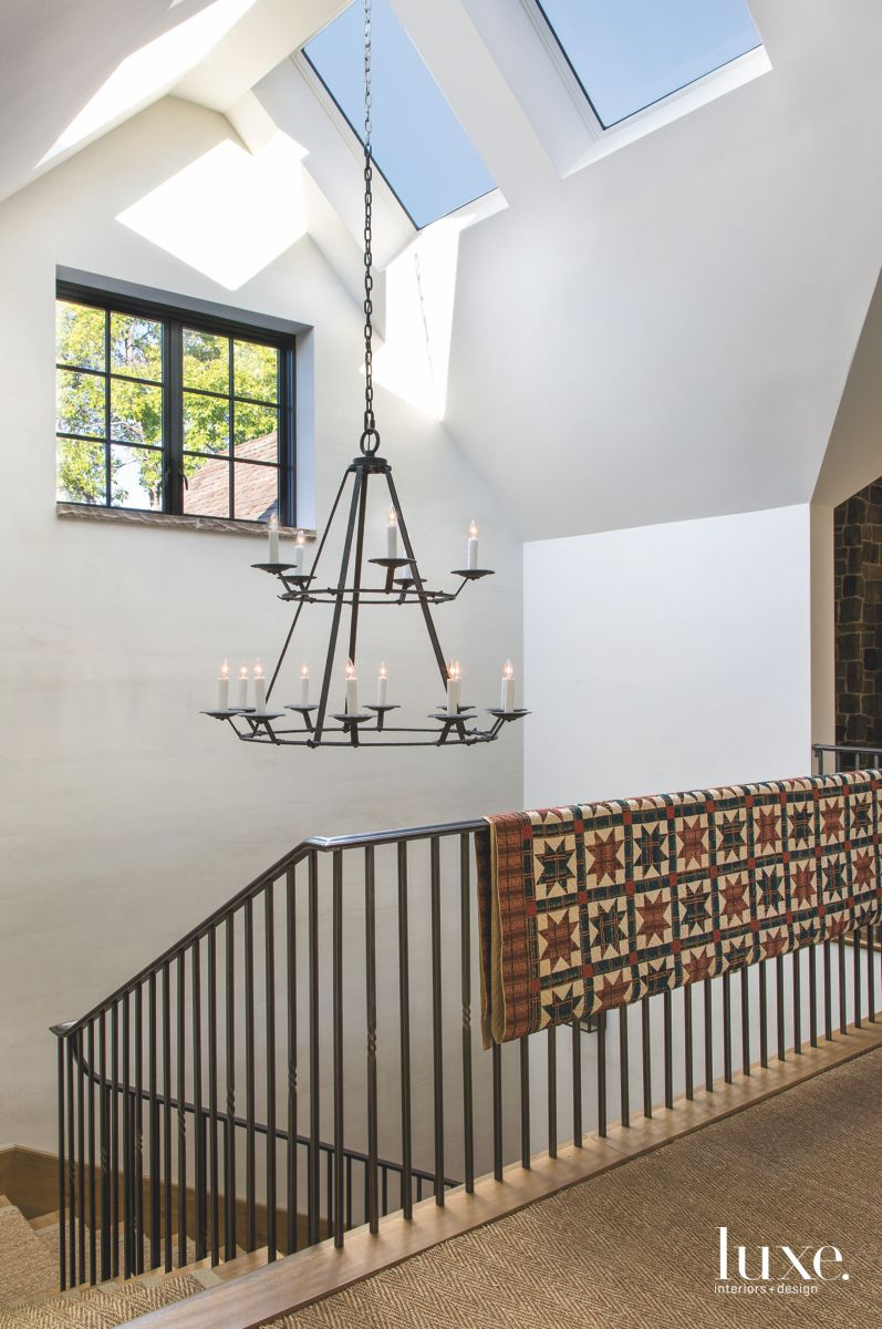 Wrought Iron Chandelier Stairwell with Vaulted Ceiling Skylights