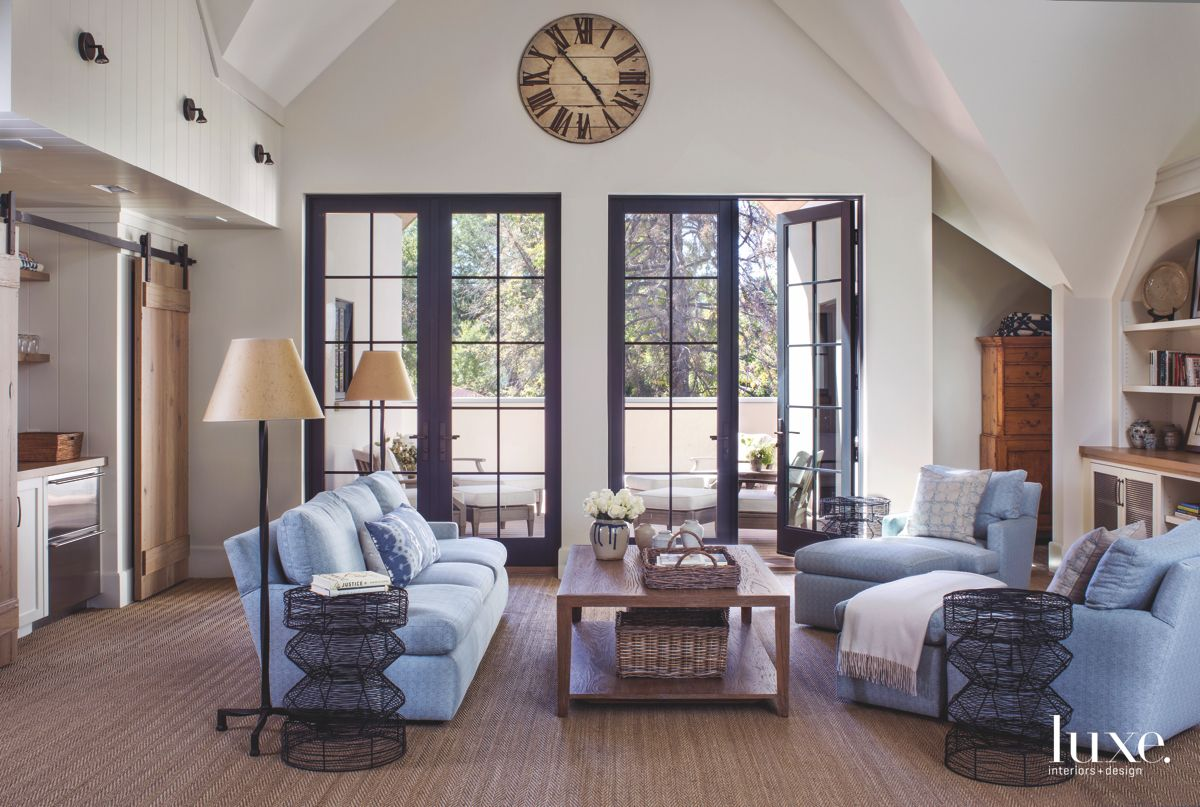 Blue Sofa Upstairs Family Room with Sliding Wood Barn Door and Clock