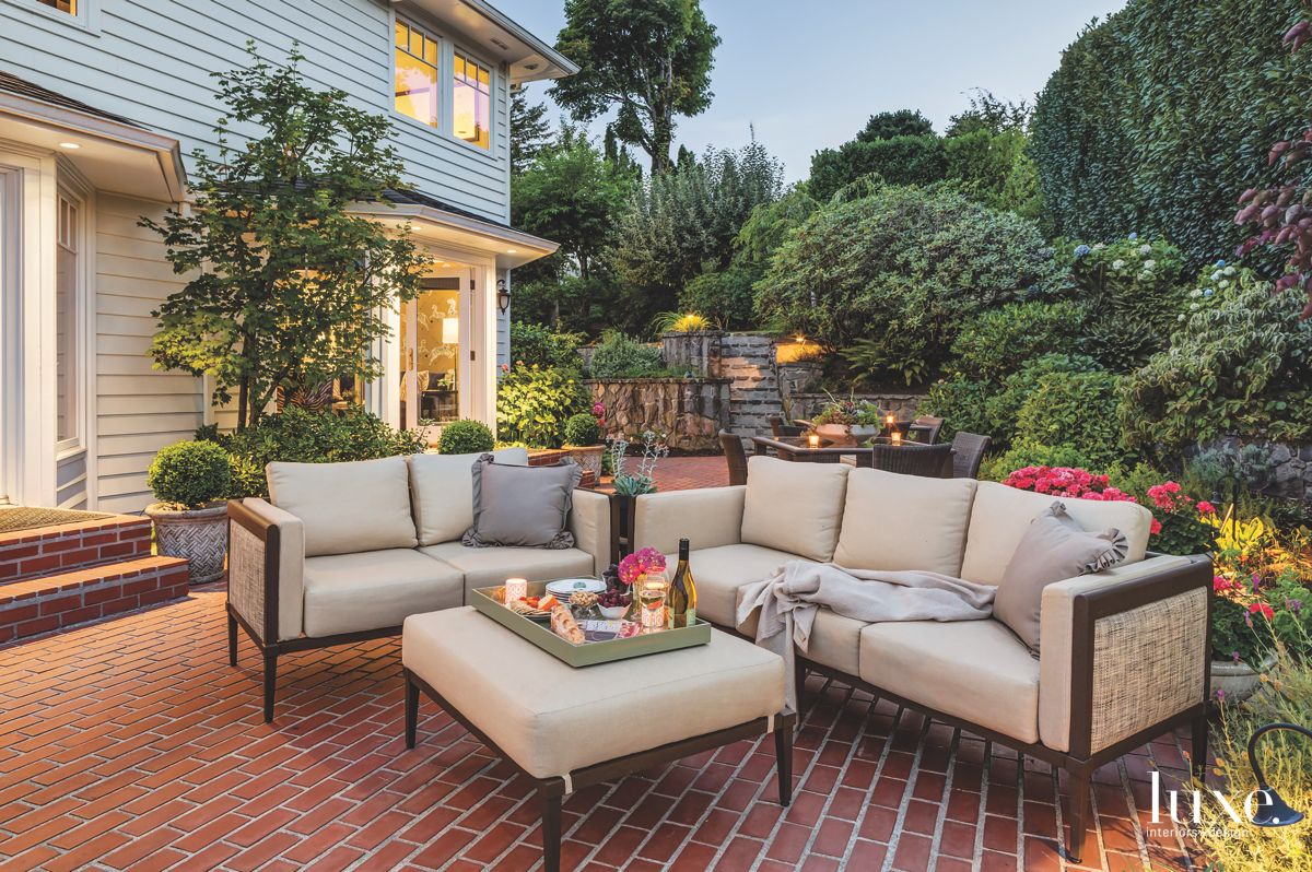 Nighttime Outdoor Patio with Outdoor Sofas Ottoman and Landscape