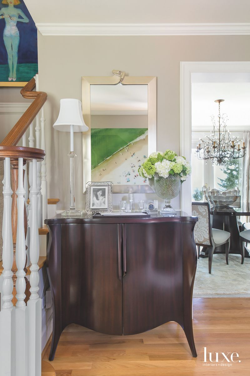 Deep Brown Cabinet with Mirror and Green Flower Staircase Peek