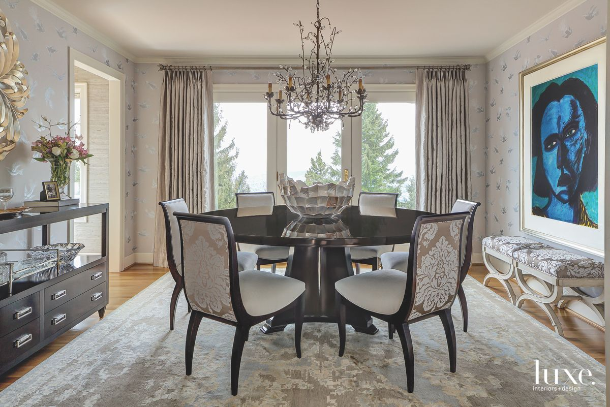Black and Blue Portrait Art Dining Room with Patterned Wallpaper and Chairs