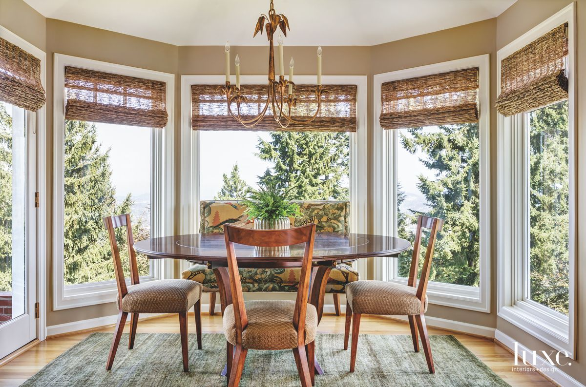 Bay Window Family Room Dining Area with Wooden Chairs and Natural Blinds