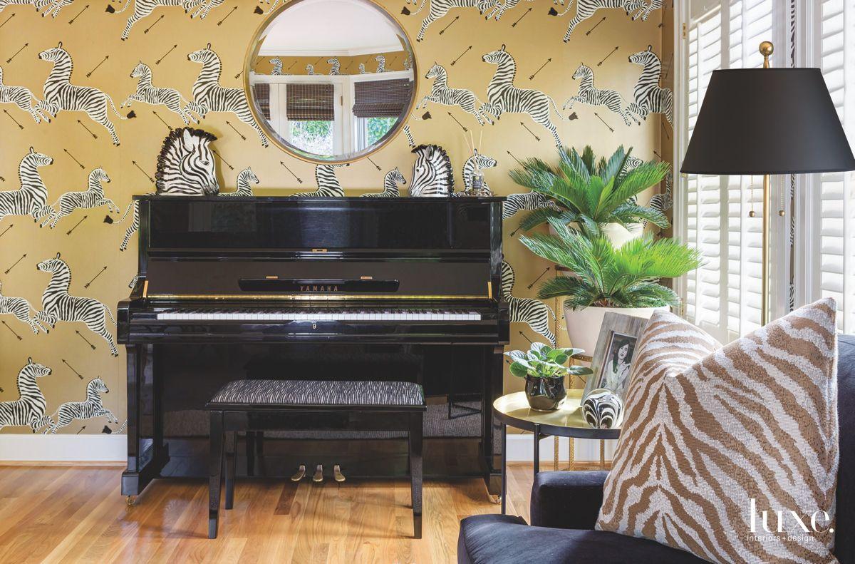 Black Zebra Piano Adjacent to Plants