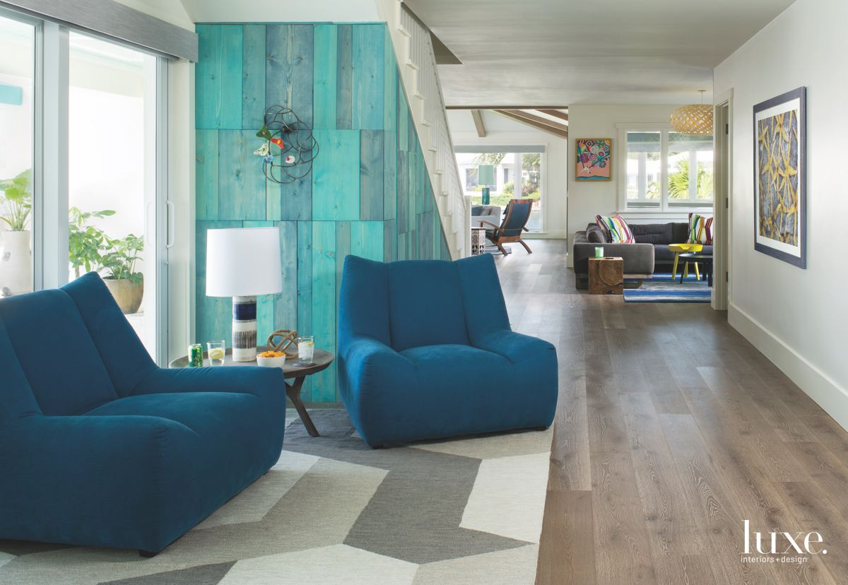 Blue Wood Pattern Sitting Area With Plush Seating and Geometric Carpet