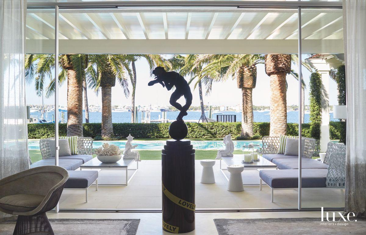 Bronze Sculpture Living Indoor Outdoor Room with Pool and Water View