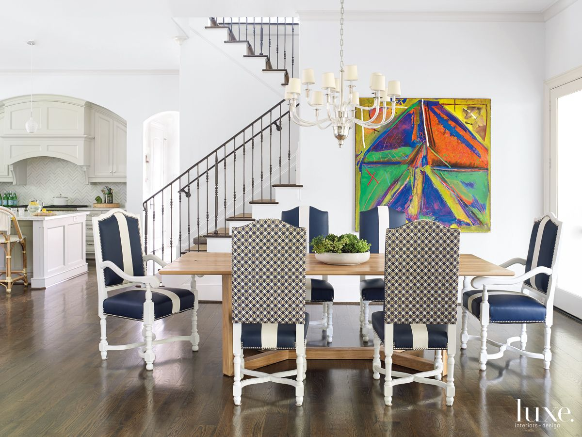 Transitional White Casual Dining Area with Colorful Oil Painting