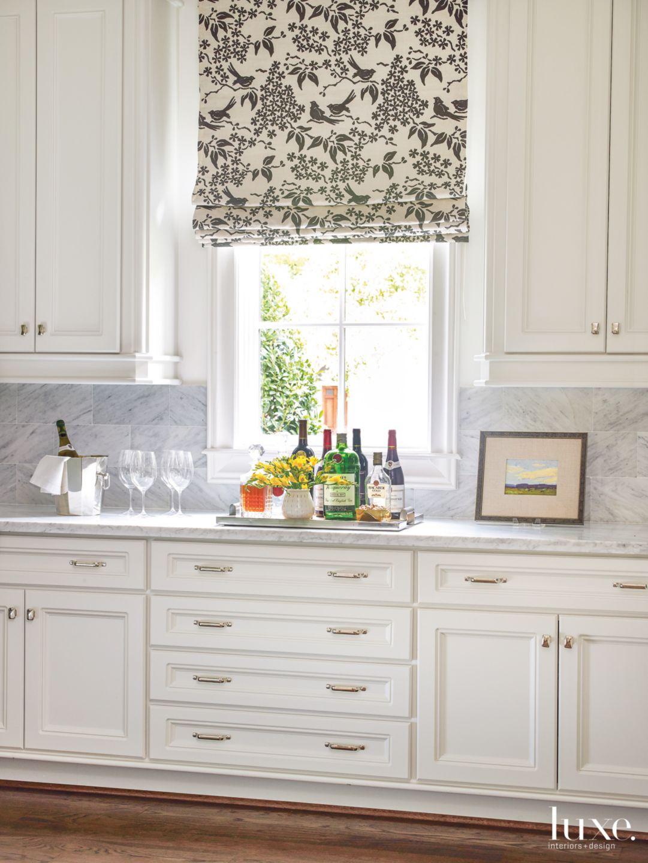 Transitional White Kitchen Detail with Bird-Print Shade