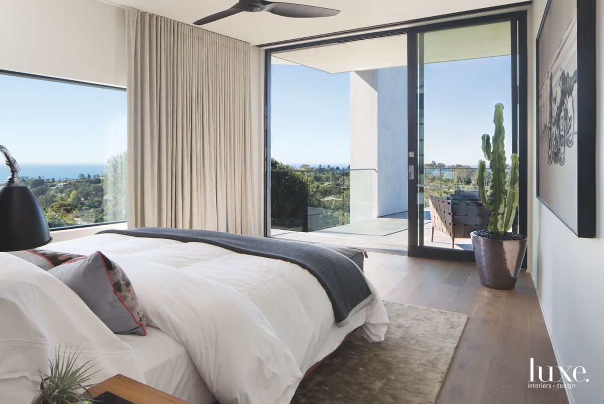 Palm Tree and Oceanic Bedroom View with Neutral Curtains and Plant