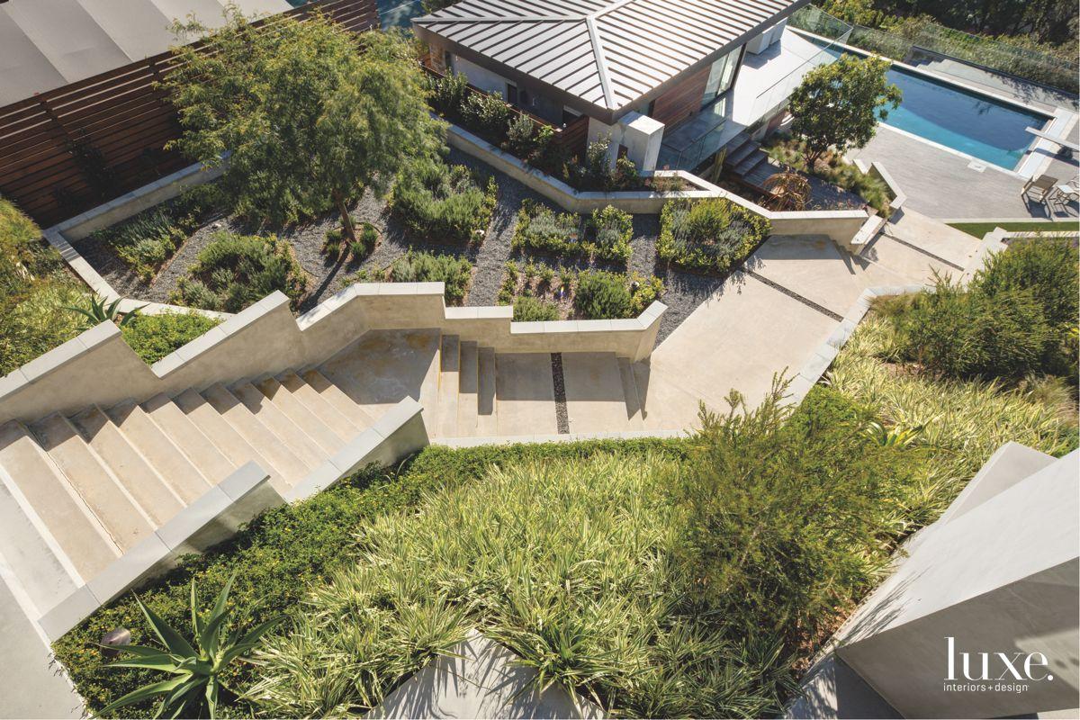 California Interpretation of an English Garden Staircases Leading to A Pool