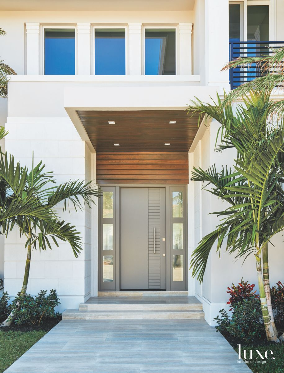 Earth-Tone Pavers Leading to White and Gray Exterior Entry