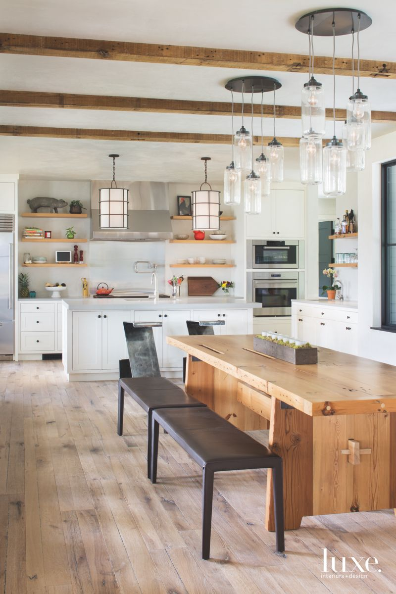 Reclaimed Beam Kitchen Ceiling with Descending Lighting Fixtures and Bench Table