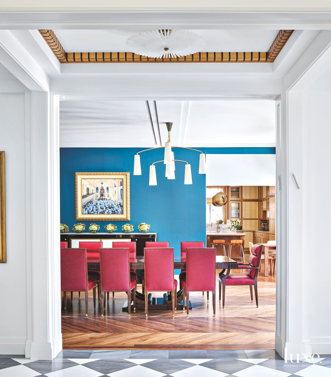 Blue Dining Room with Red Seating and Light Fixture
