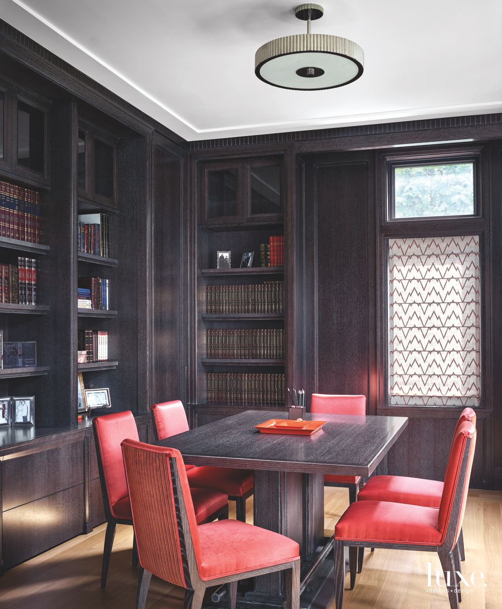 Dual Desk and Conference Table in Wooden Office with Red Chairs