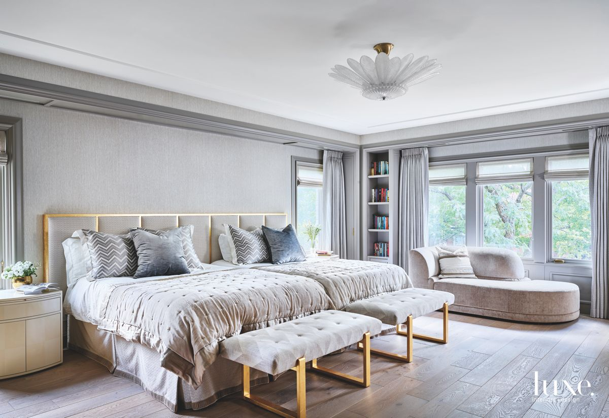 Gilded Accent Gray Master Bedroom with Flower Light Fixture