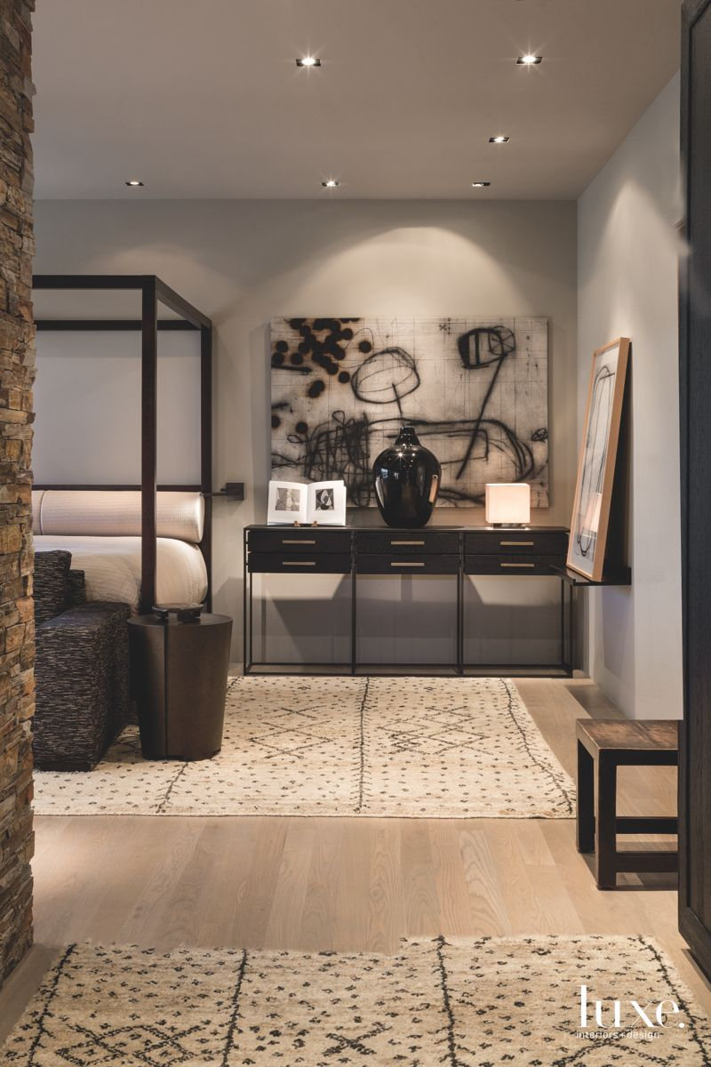 Black Artwork Master Bedroom with Four Poster Bed, Neutral Wood Flooring and Storage