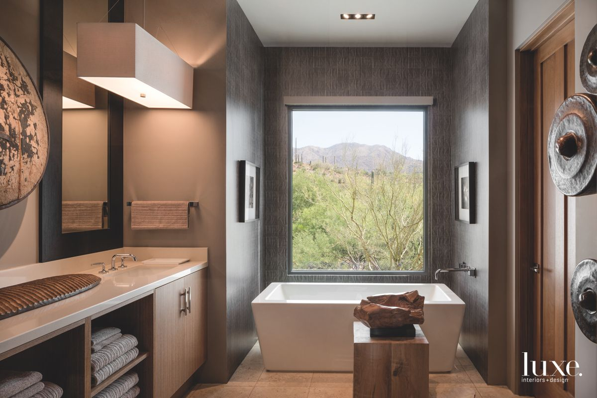 Large Ceramic Soaking Tub with Desert Views and Wooden Aesthetic Pieces