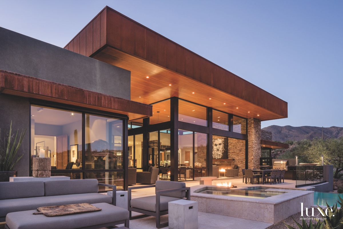 Twilight Contemporary Arizona Glass Exterior Home with Jacuzzi and Pool