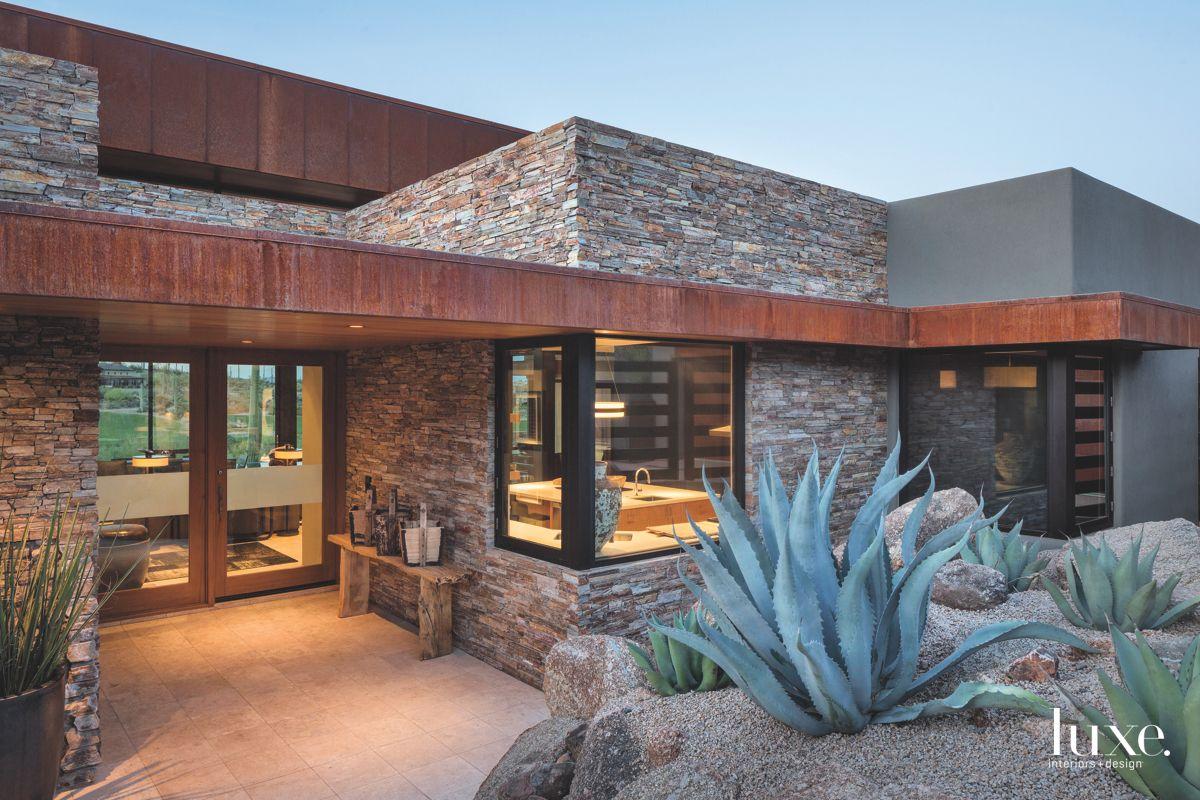 Red Rocks Stone Arizona Contemporary Home Exterior with Cactus Plant