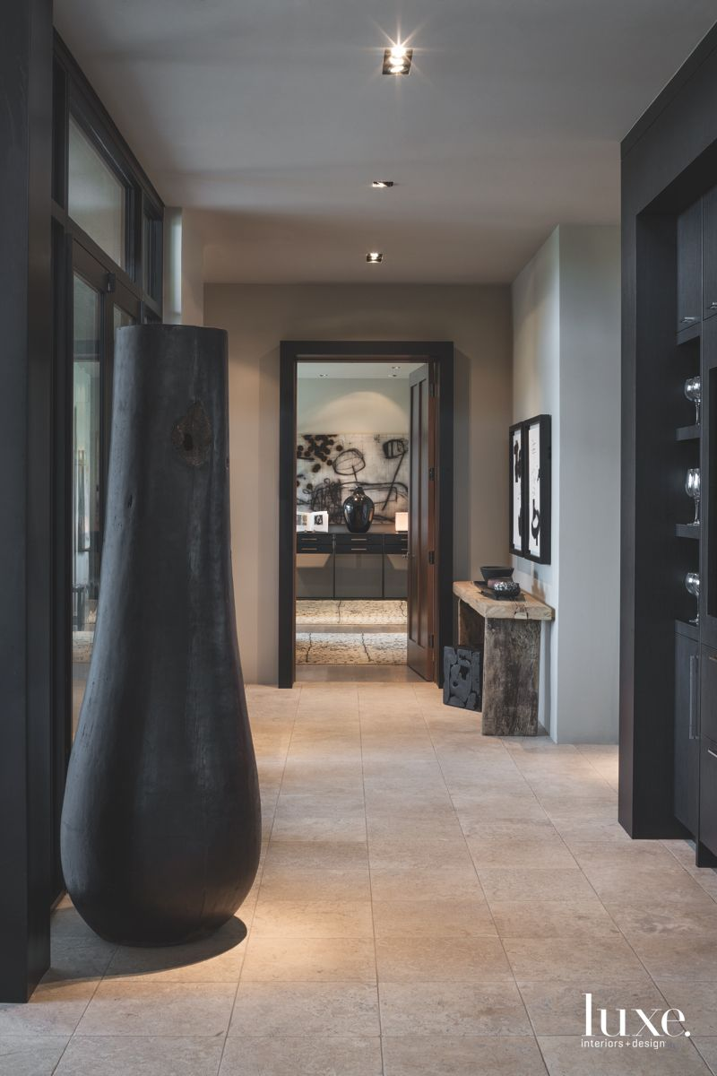 Black Palm Vessel Hallway with Stone Flooring and Side Table