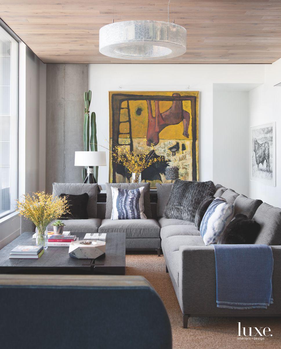 Art Filled Living Room with Circular Lighting and Corner Sofa