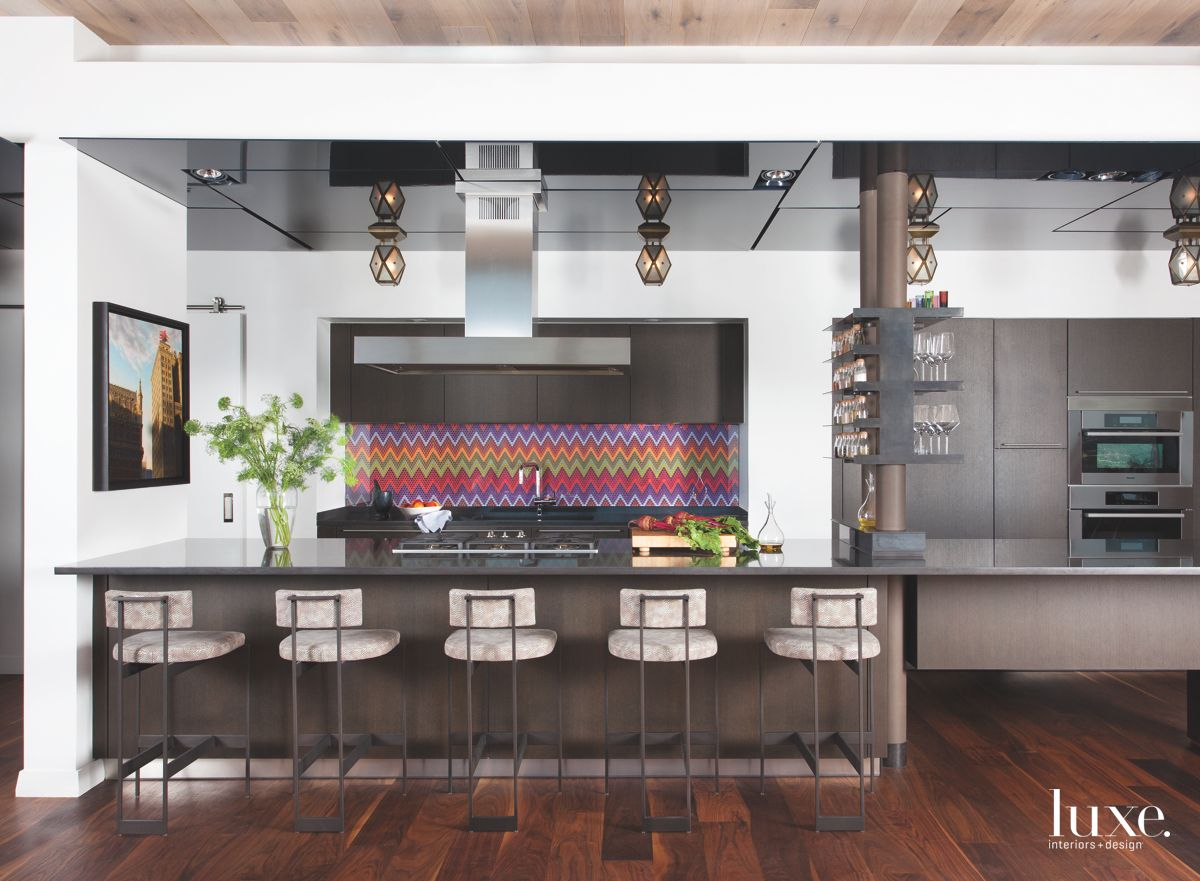 Colorful Chevron Kitchen Backsplash with Pendants and Barstools