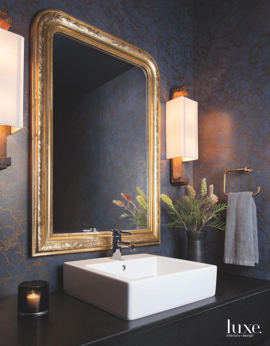 Antique Mirror and Wide Bathroom Sink in a Moody Powder Bathroom
