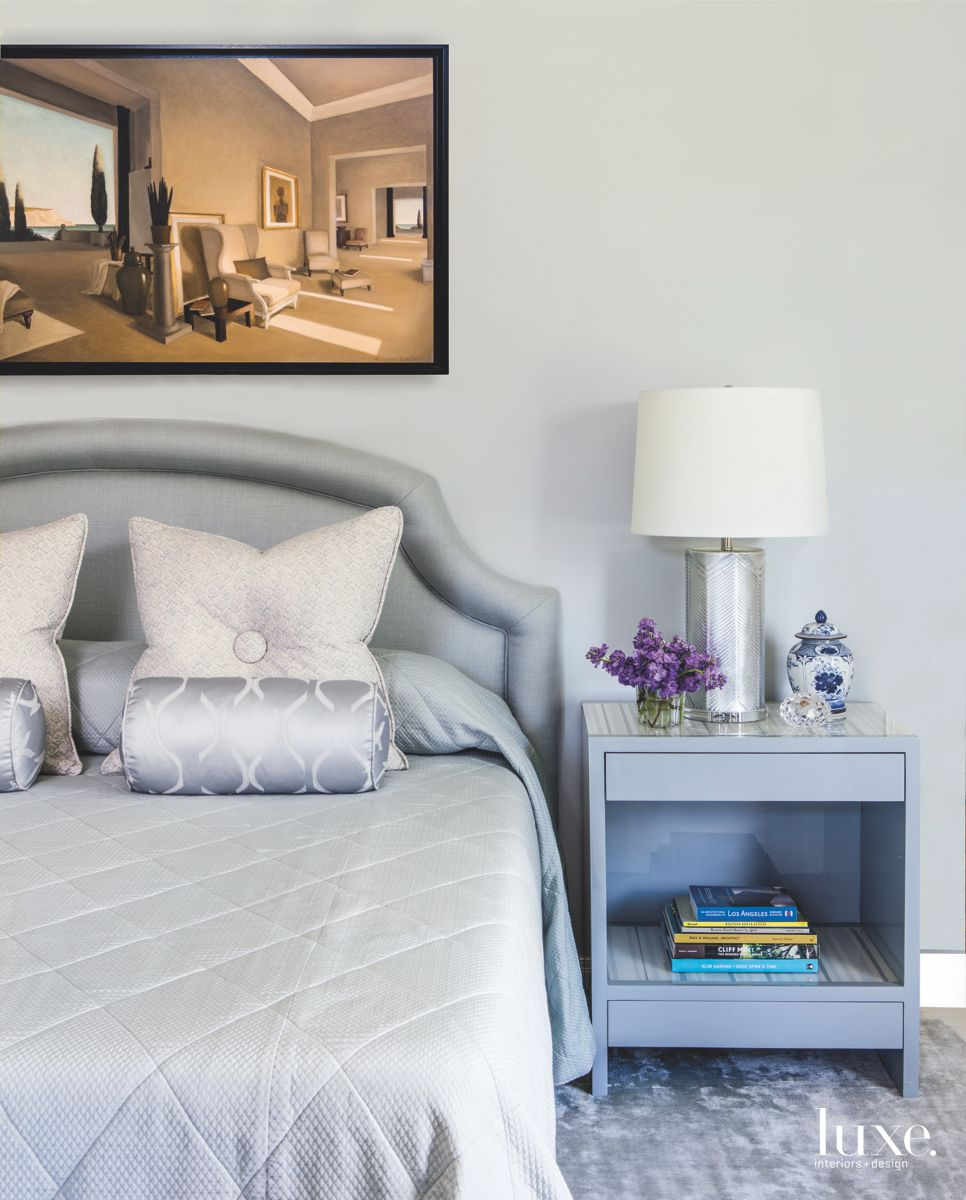 Interior Room Artwork Bedroom with Silver Accented Bedding and Side Table Lamp