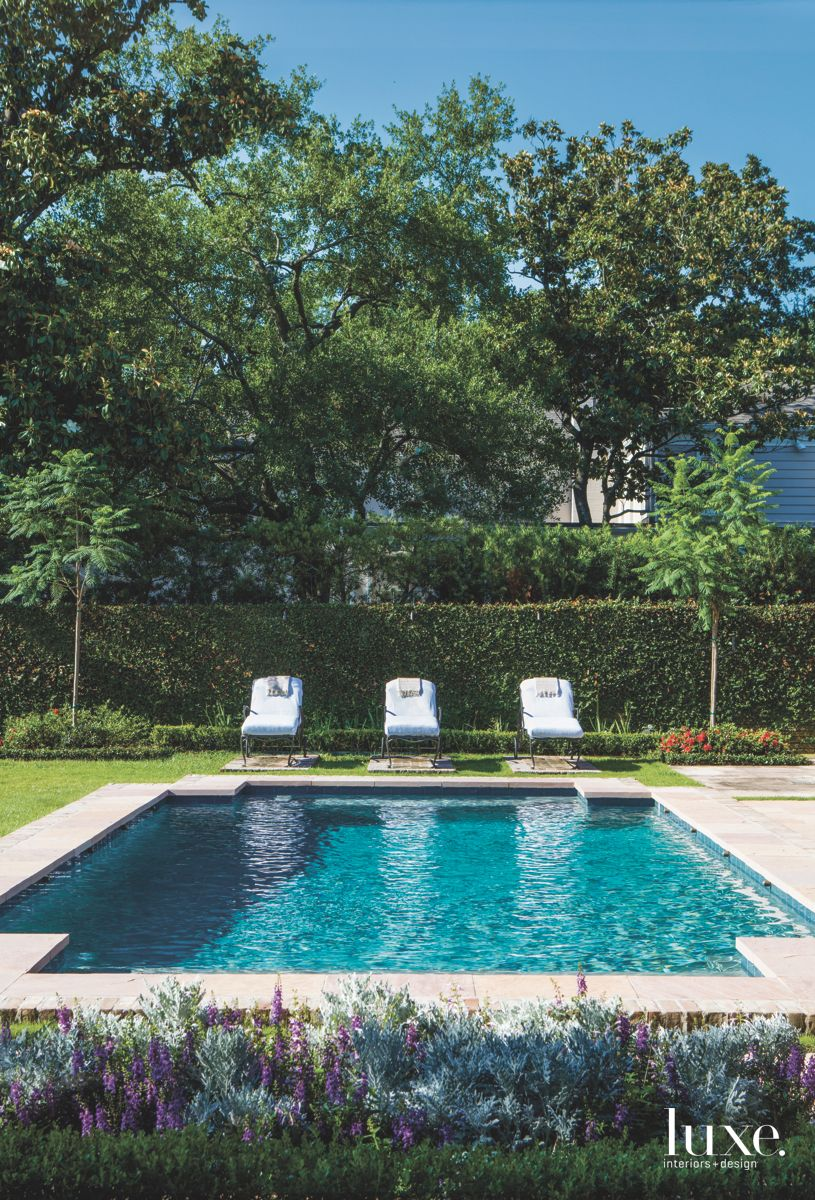 Geometric Shape Pool with Three Lawn Chairs and Lush Surround