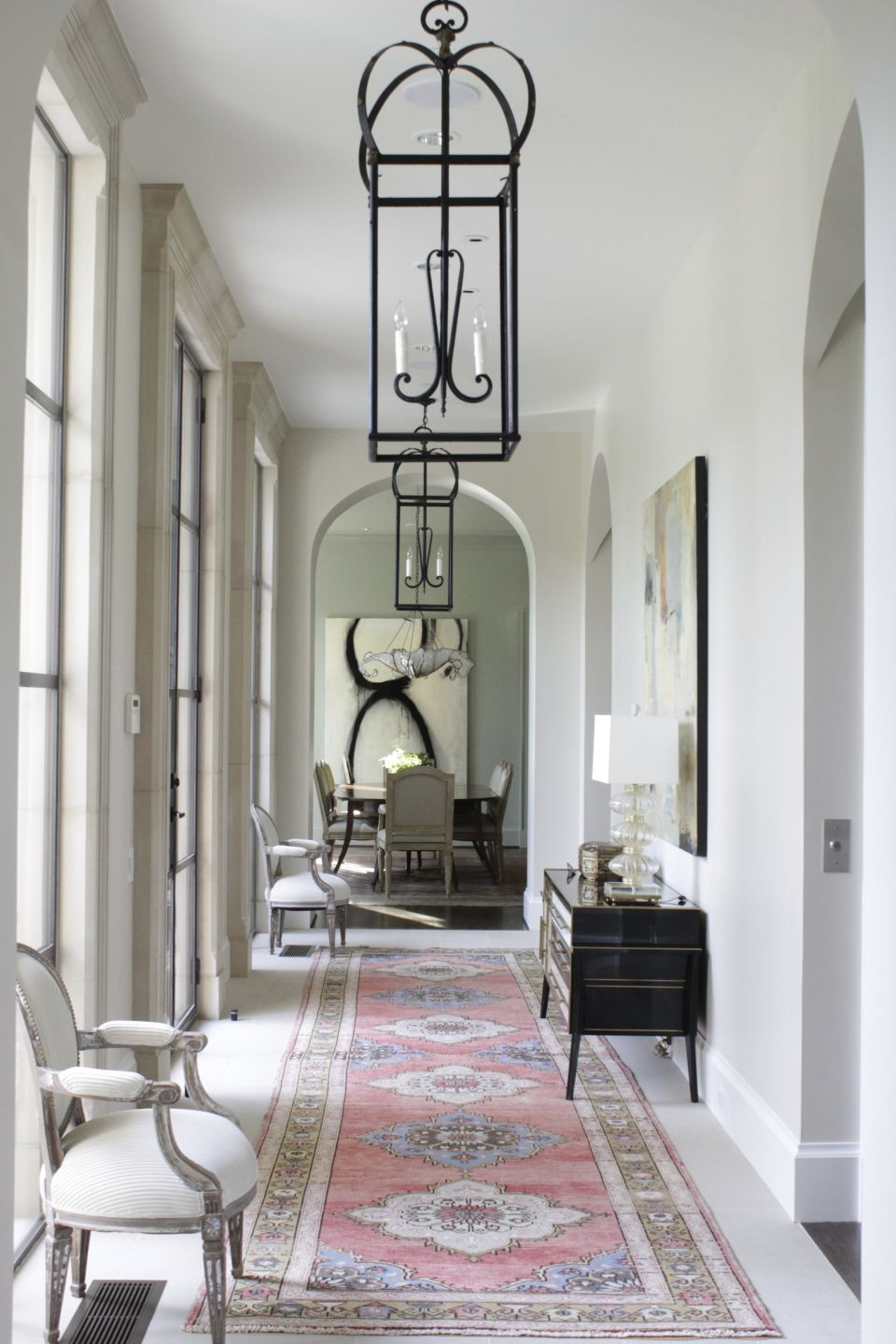 Transitional White Hallway with Antique French Lanterns