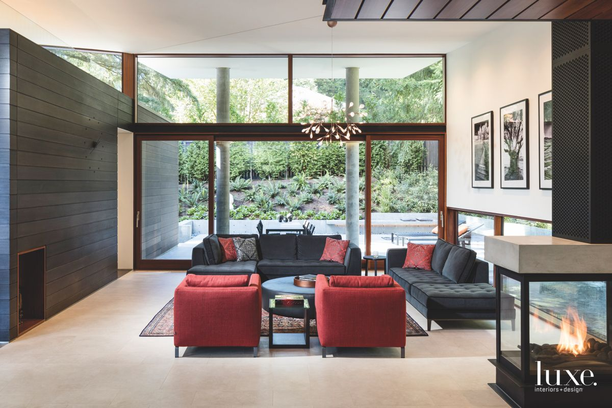 Red Chair Living Room with Contained Fireplace with Photographs