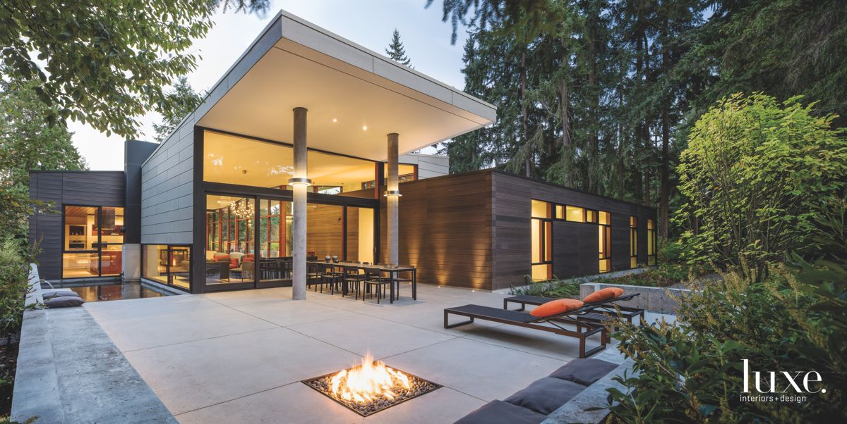 Contemporary Roofline Exterior with Lounge Chairs and In-Ground Firepit