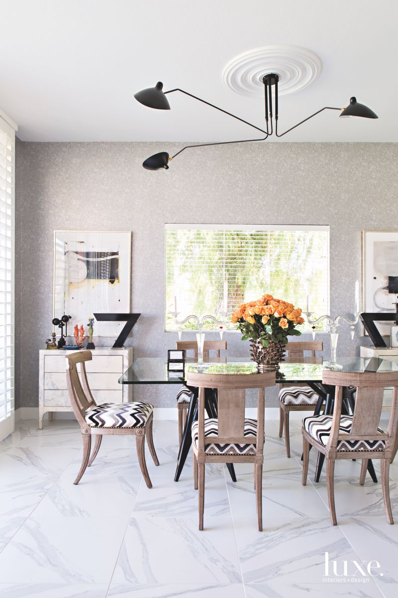 Eclectic Dining Room with Chevron Seating, Light Fixture, and Furnishings