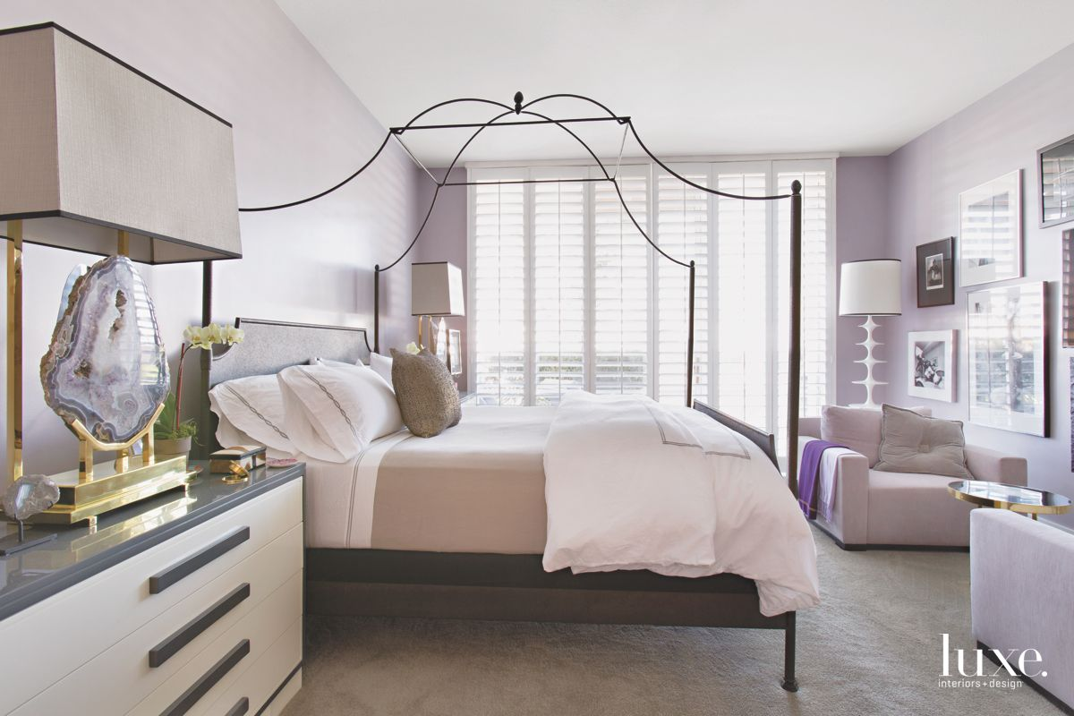 Gray-Lavender Master Bedroom with Delicate Four Poster Bed and Geode Lamp