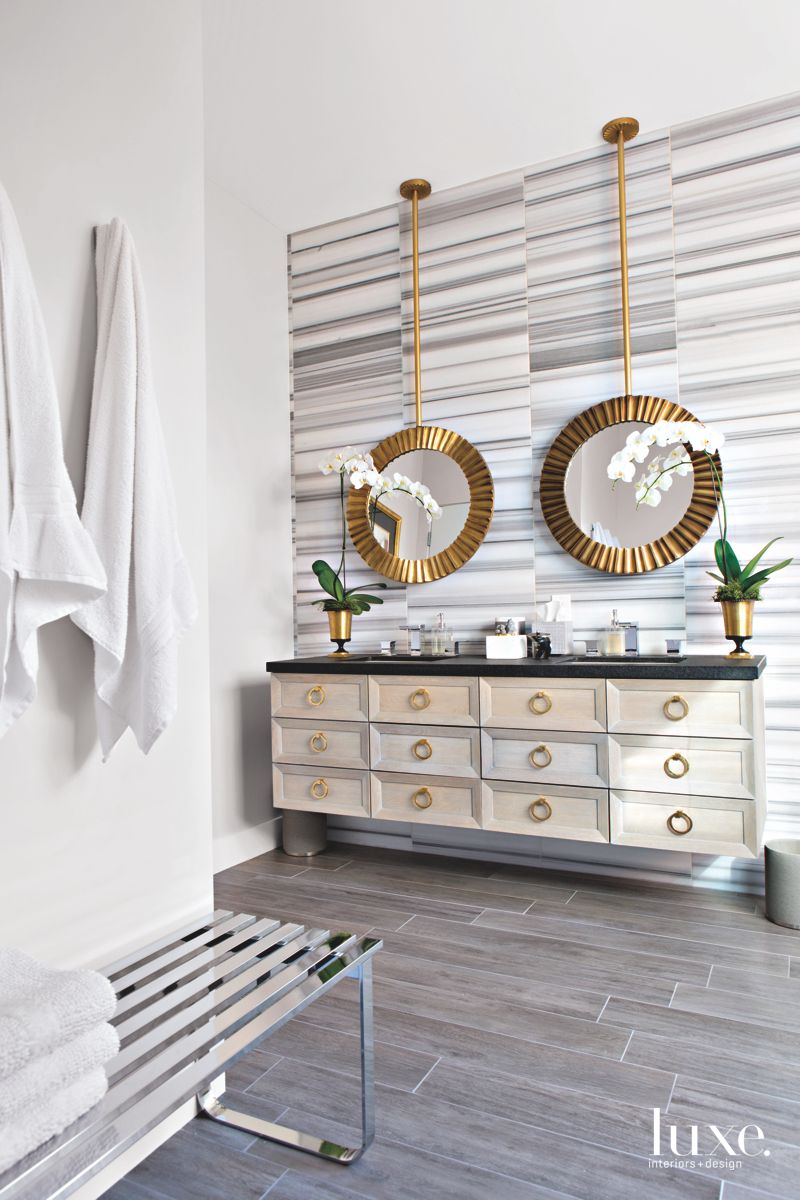 Offset Striped Marble Feature Master Bathroom Wall with Mirrors